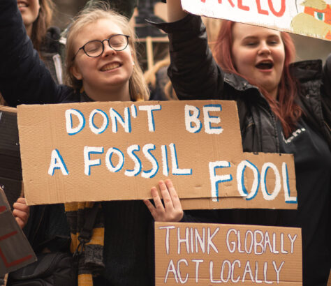 Protestor with a sign : don't be a fossil fool