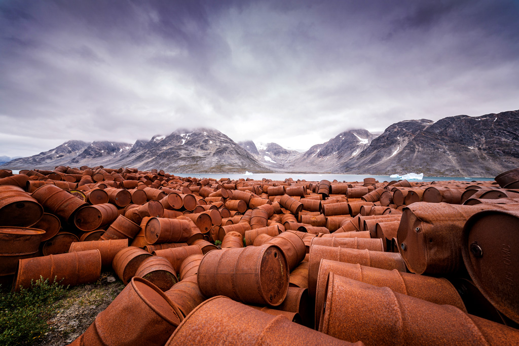 Thousands of oil drums littering a beach in Greenland.