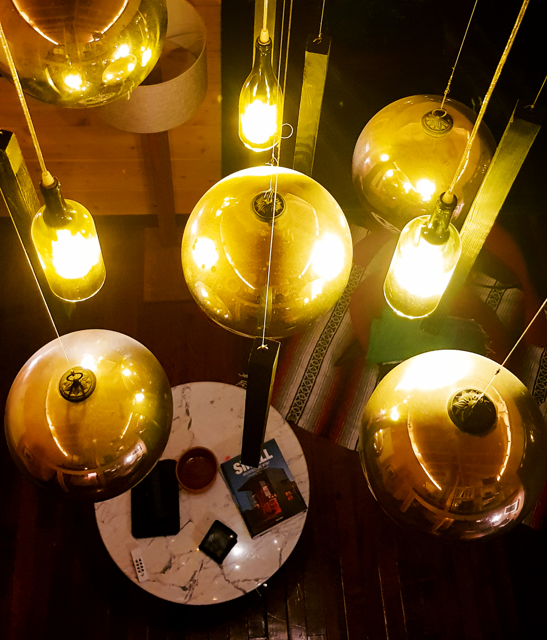 Upcycled Feature light from recycled bottles, recycled wood studs and recycled mirror bulbs