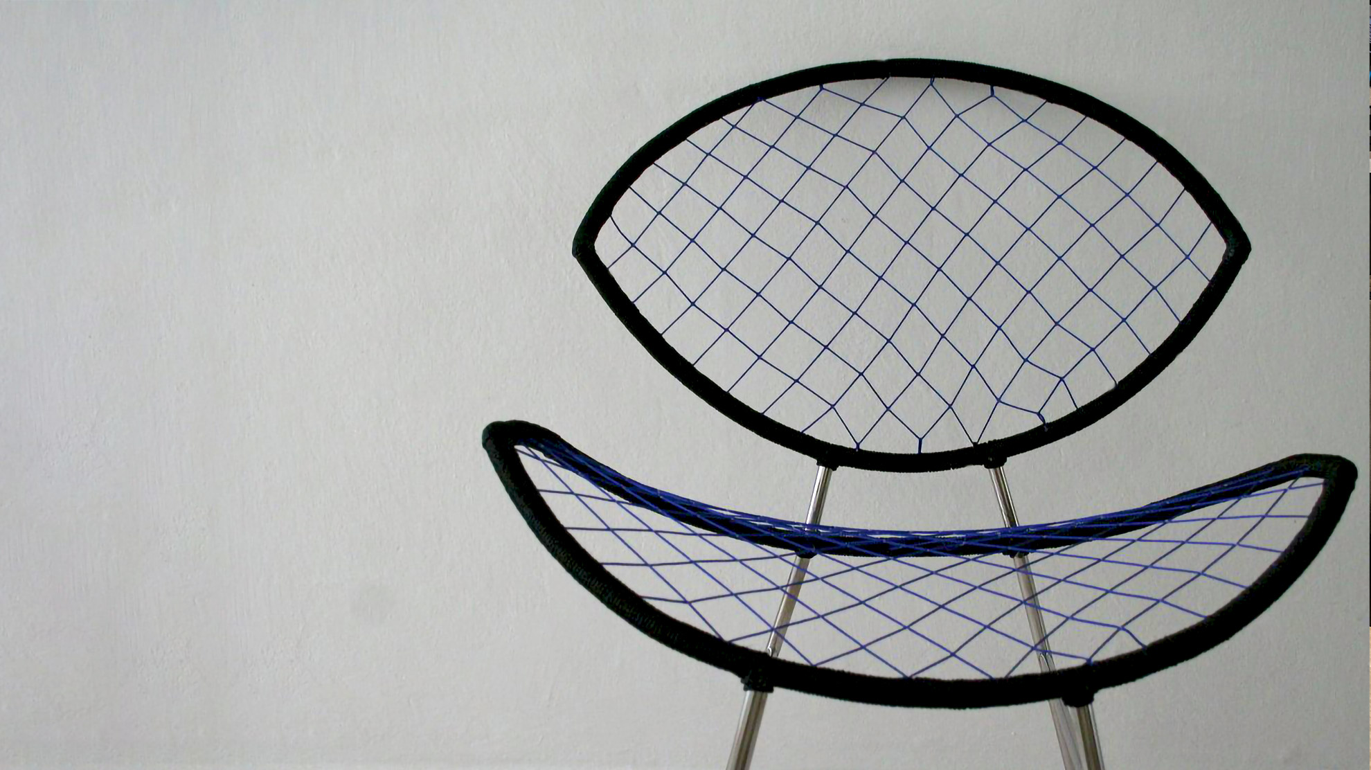 Chair made with recycled fishnets and metal bars