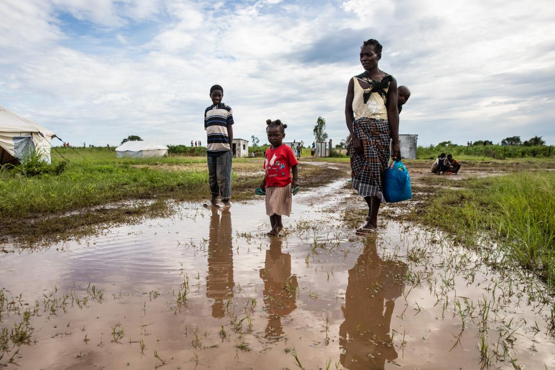 A family make their way to a relocation centre in Mozambique having been displaced by Tropical Cyclone Eloise, January 2021. Photo credit: UNICEF