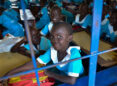 A young girl and her school friends in school, Juba, South Sudan