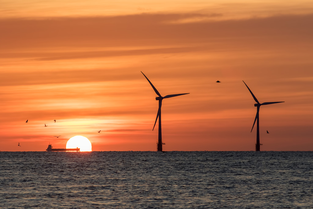 A switch to a more sustainable energy source such as wind and solar power can help achieve the goals set out by the Paris agreement.